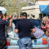 لاجئون سوريون يعودون إلى بلادهم