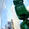 سحب نصب بلون العلم السعودي من موقع مركز التجارة العالمي
